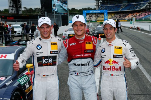 Tambay (centre) celebrates with Wittmann (left) and da Costa (right). © DTM.
