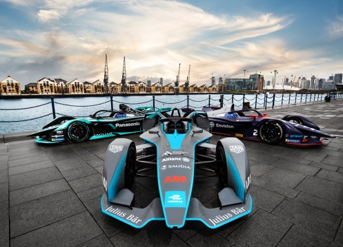 A_trio_of_fully-electric_cars_lined-up_in_formation_outside_ExCeL_London_-_the_scene_of_Formula_E_s_racing_return_to_the_UK_capital_in_season_six